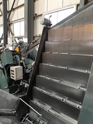 ローリングマシン材料供給機